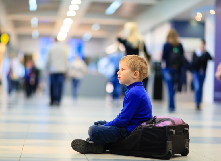 little boy waiting in the airport, kids travel